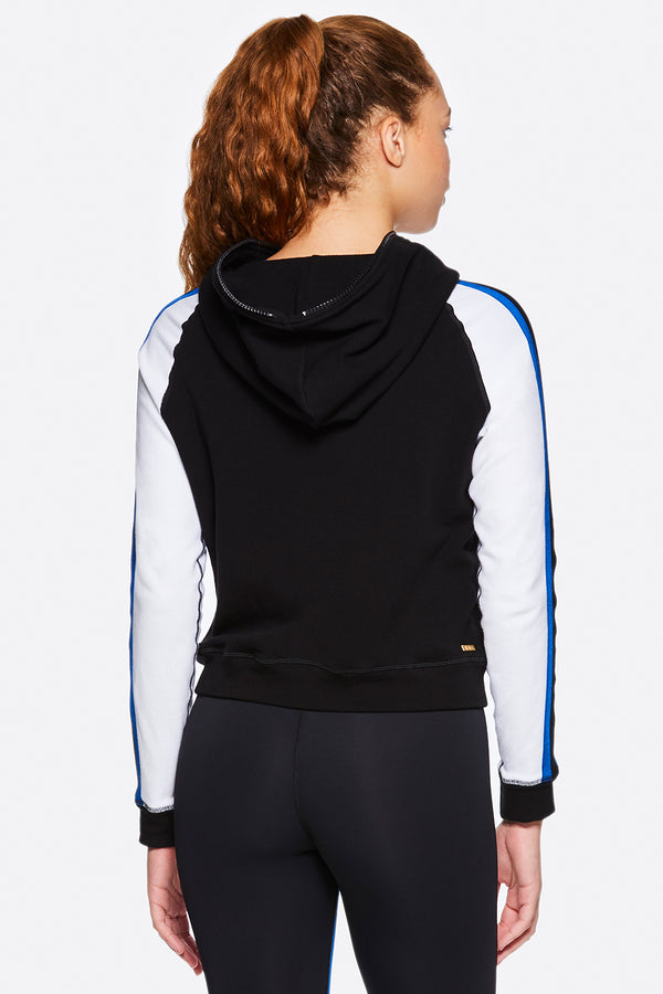 Front view of Alala Women's Luxury Athleisure black/white/blue color-blocked zip-up hoodie