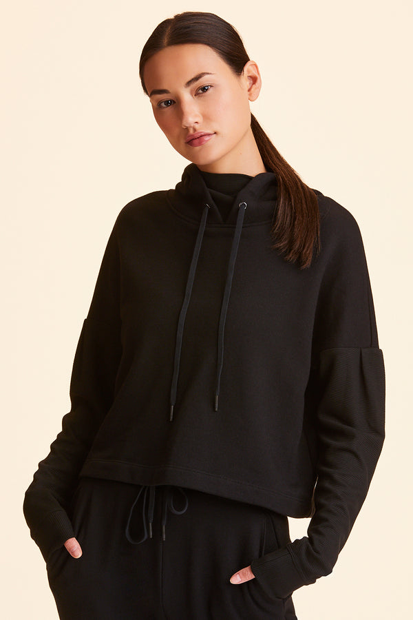 3/4 view of Alala Women's Luxury Athleisure cropped hoodie in solid Black