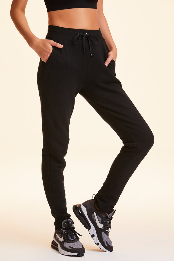 Front view of Alala Women's Luxury Athleisure sweatpant in solid Black