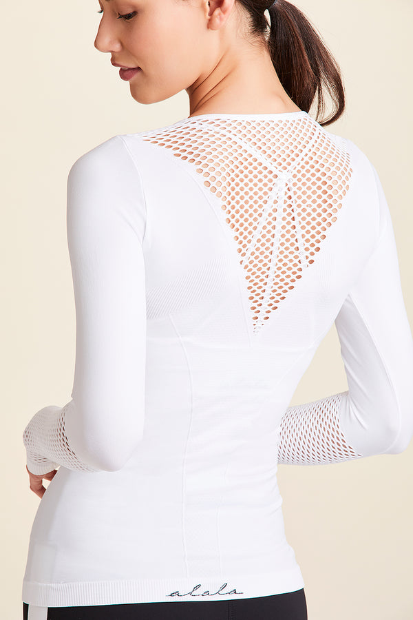 Front view of Alala Women's Luxury Athleisure white seamless long sleeve tee with mesh detailing