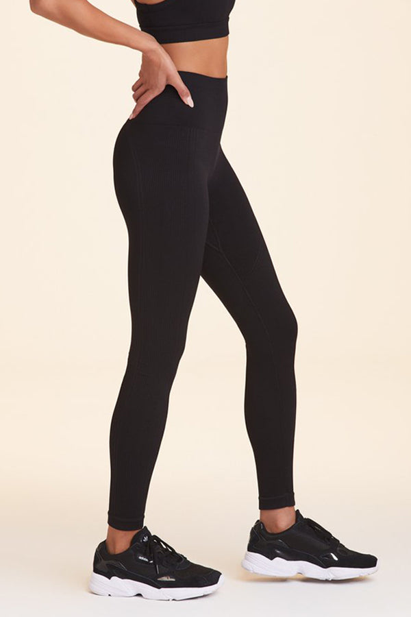 Side view of Alala Women's Luxury Athleisure black seamless tight