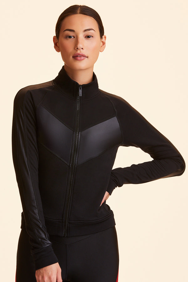 3/4 close-up of Alala Women's Luxury Athleisure black soft fabric track jacket with liquid jersey accent