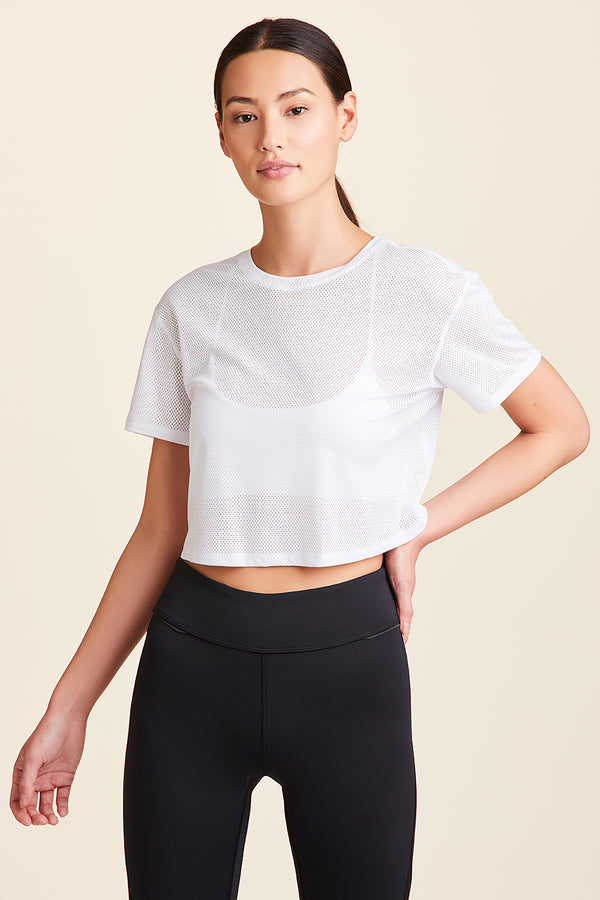 Front view of Alala Women's Luxury Athleisure white mesh crop tee