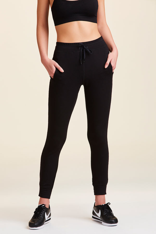 Front view of Alala Women's Luxury Athleisure black sweatpant