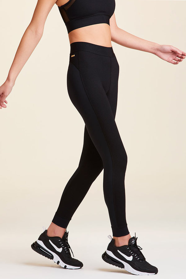 Side view of Alala Women's Luxury Athleisure thermal tight