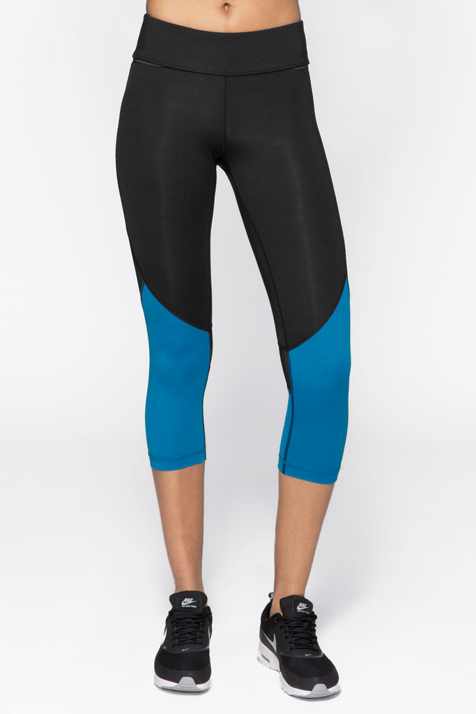 Captain Crop Tight in Black & Bolt Blue, $74 | Alala | Luxury Womens Activewear | Style meets Sport