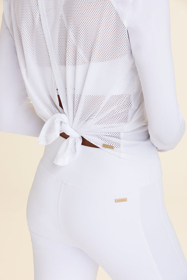 Back view of Alala Women's Luxury Athleisure white long sleeve tie back