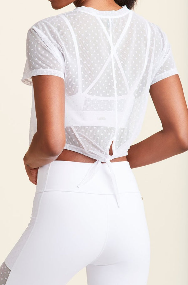 Back view of Alala Women's Luxury Athleisure white mesh tee with polka dot detail