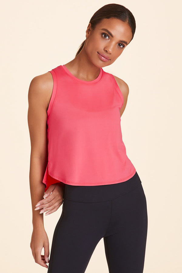 Side view of Alala Women's Luxury Athleisure watermelon-colored tank