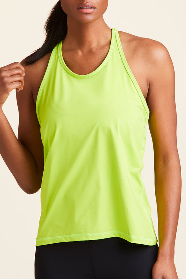 Front view of Alala Women's Luxury Athleisure lime T back tank