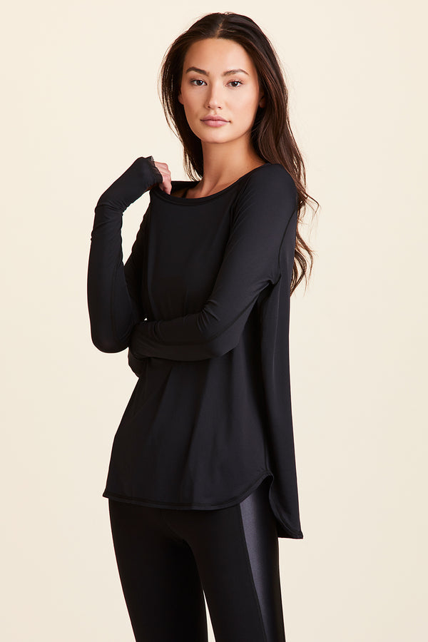 3/4 front view of Alala Women's Luxury Athleisure black long sleeve tee