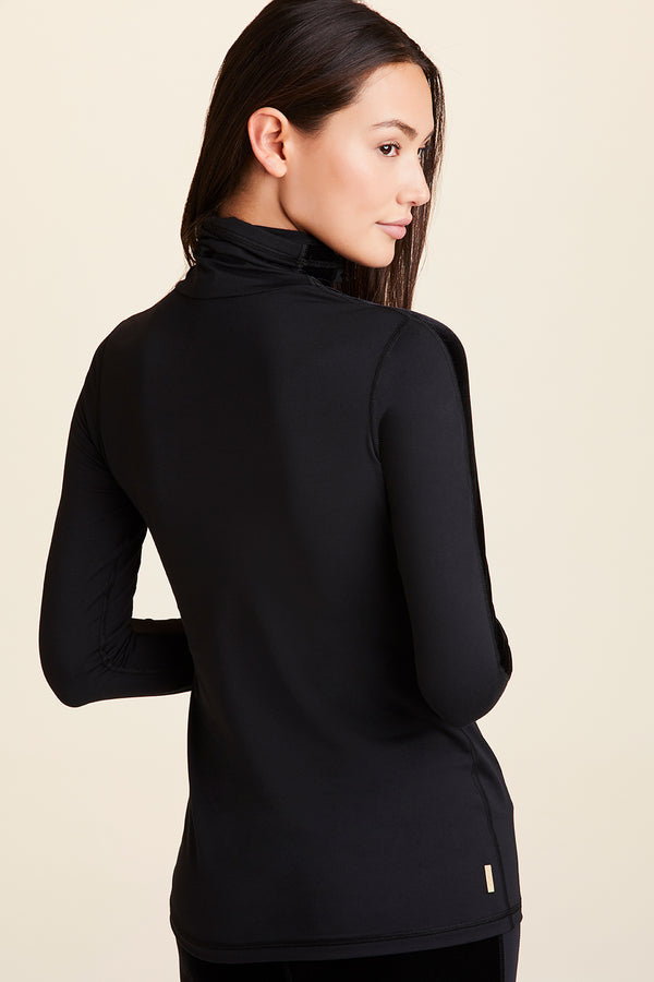 Front view of Alala Women's Luxury Athleisure turtleneck with mesh sleeve detail