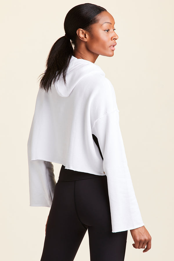Side view of Alala Women's Luxury Athleisure white cropped hoodie with  minimal detail