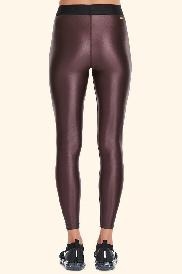Side view of Alala Women's Luxury Athleisure shiny burgundy tight