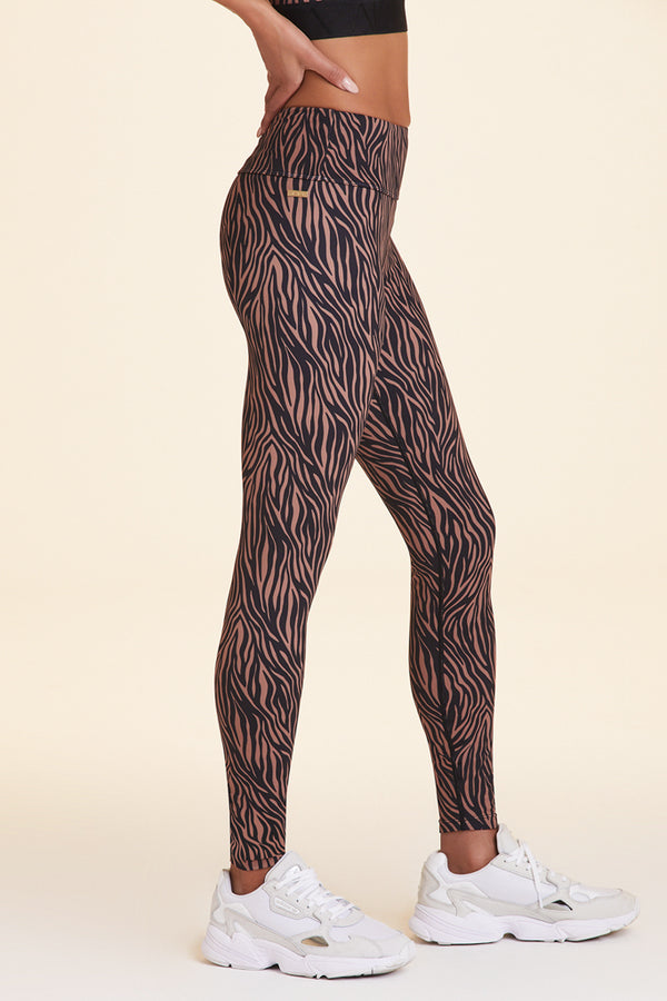 Side view of Alala Women's Luxury Athleisure zebra print tight