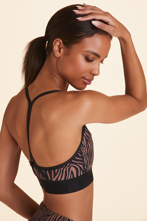 Side view of Alala Women's Luxury Athleisure zebra print sports bra