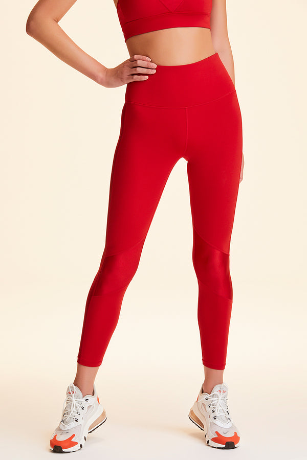 Side view of Alala Women's Luxury Athleisure red tight