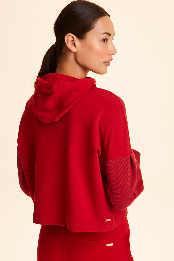 Front view of Alala Women's Luxury Athleisure cropped hoodie in solid Ruby