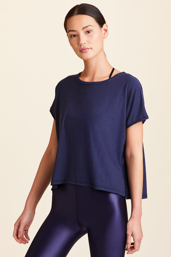 3/4 view of Alala Women's Luxury Athleisure super-soft tee in solid Navy