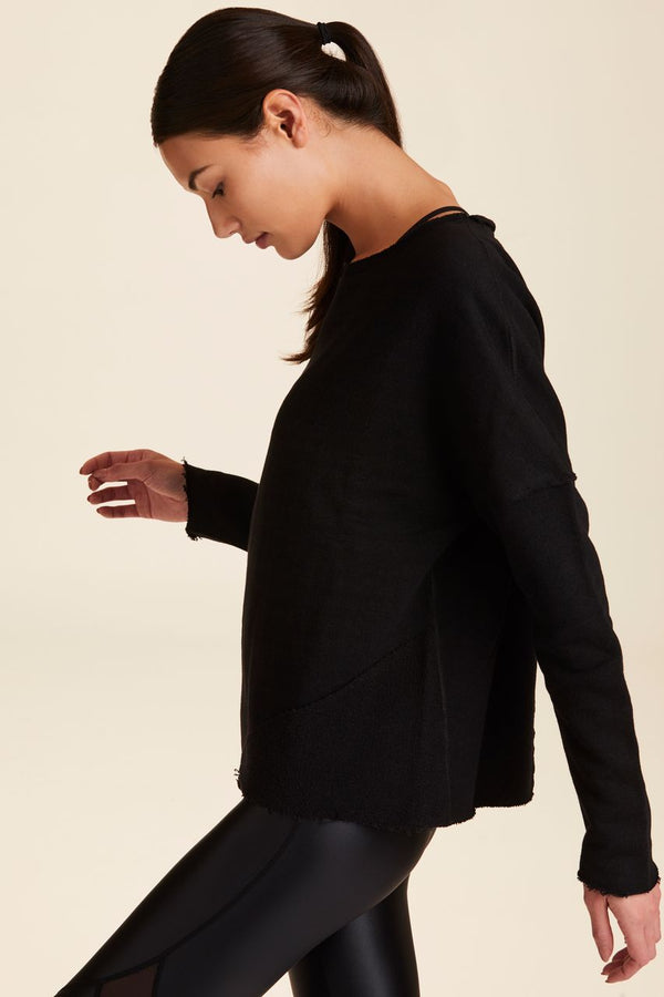 Front view of Alala Women's Luxury Athleisure black sweatshirt with distressed details on seams
