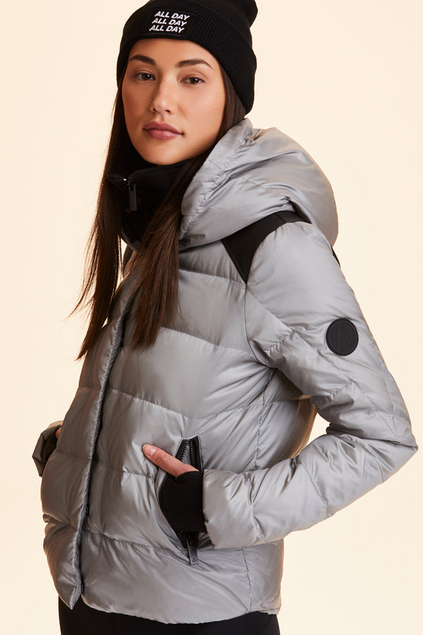 Front view  of Alala Women's Luxury Athleisure silver puffer jacket