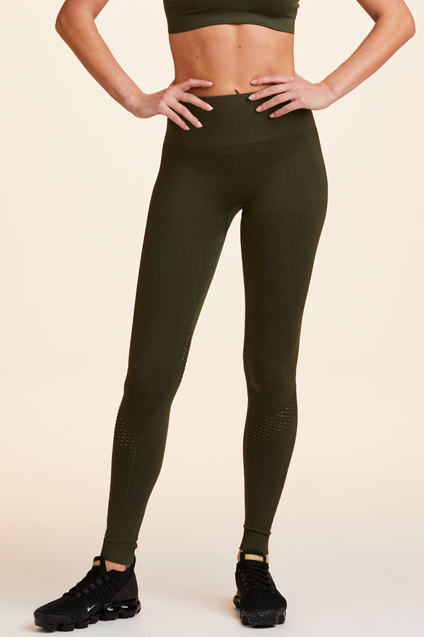 Side view of Alala Women's Luxury Athleisure army green seamless tight with mesh detailing