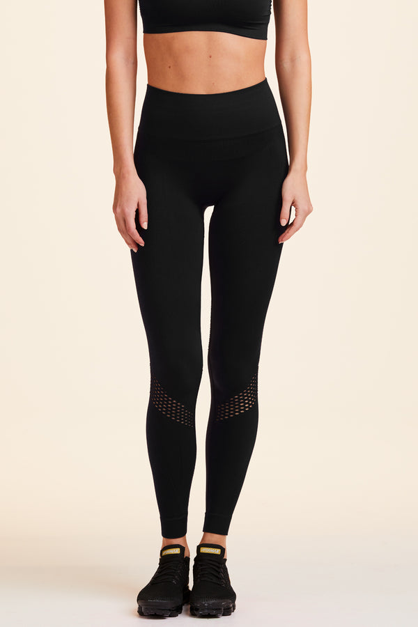 3/4 view of Alala Women's Luxury Athleisure black seamless tight with mesh detailing