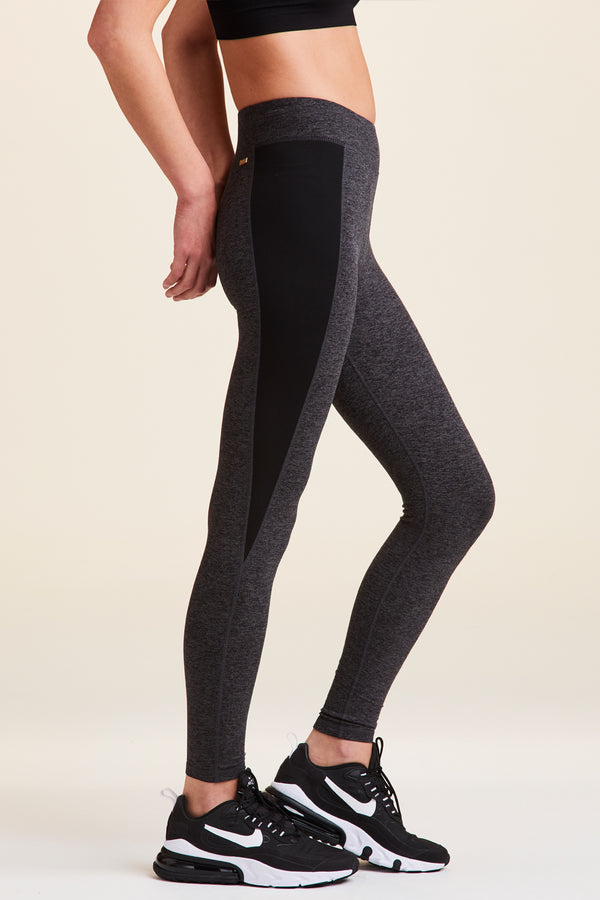 Side view of Alala Luxury Women's Athleisure charcoal grey tights with black side panel