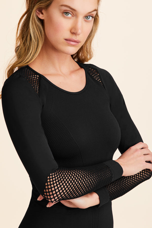 Back view of Alala Women's Luxury Athleisure black seamless long sleeve with mesh detailing