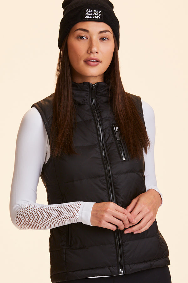 Front view of Alala Women's Luxury Athleisure black puffer vest