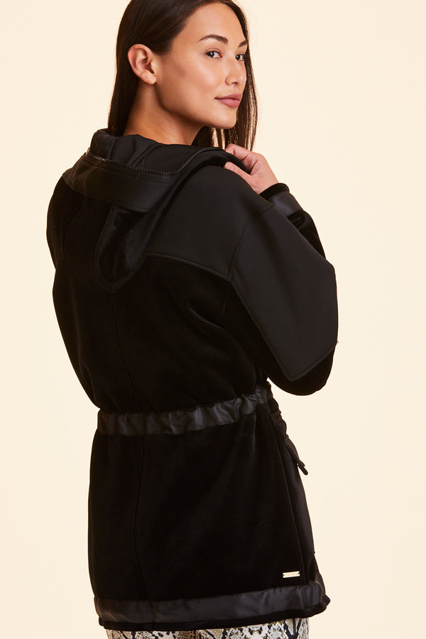 Back view of Alala Women's Luxury Athleisure black velvet jacket
