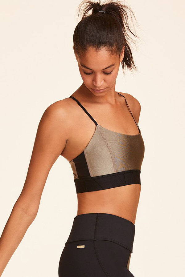 Front view of Alala Luxury Women's Athleisure gold sports bra with thin adjustable straps + elastic band