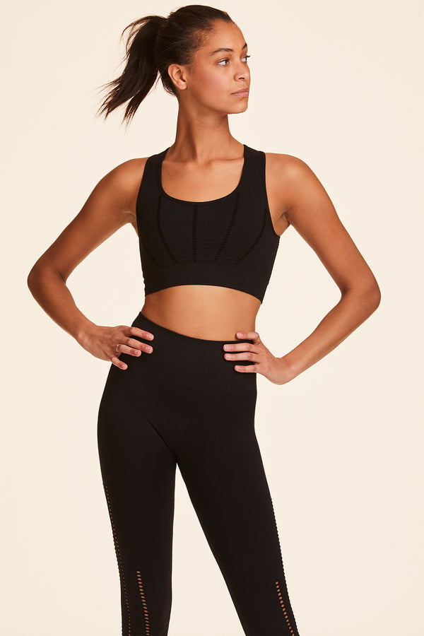Back view of Alala Women's Luxury Athleisure black seamless sports bra