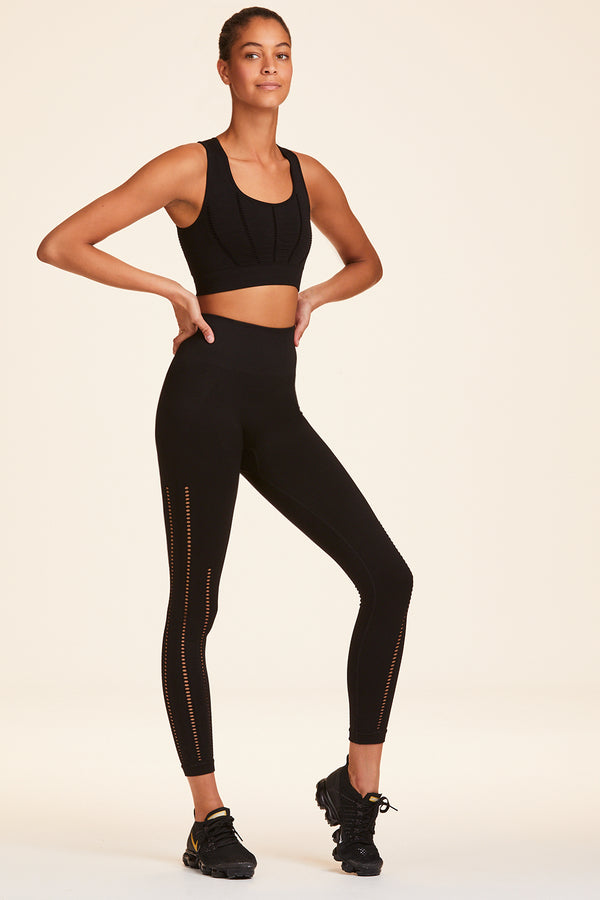 3/4 view of Alala Women's Luxury Athleisure black seamless 7/8 tight