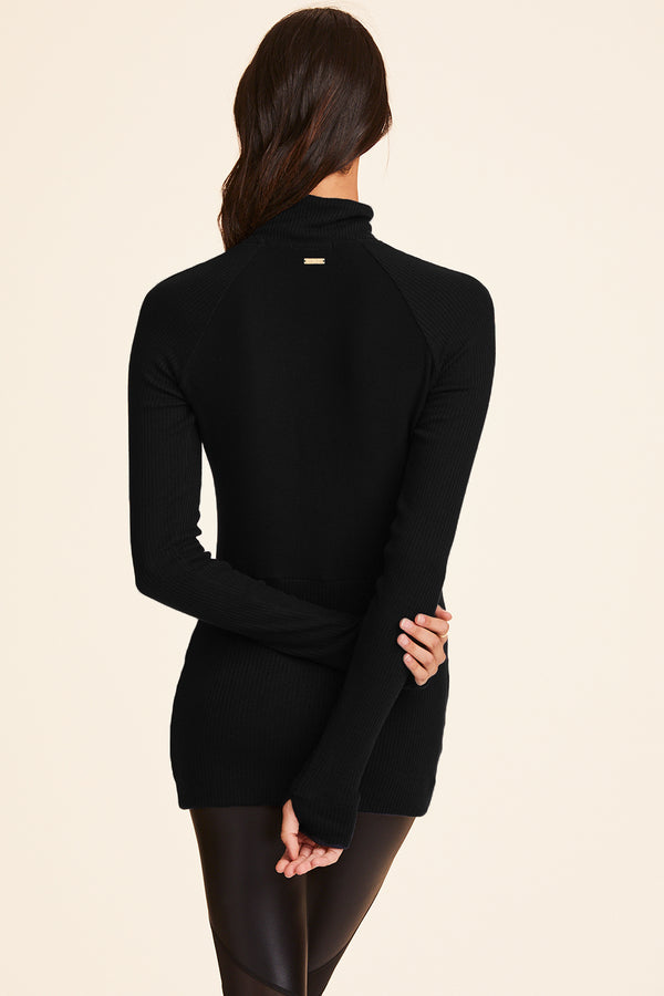 Front view of Alala Women's Luxury Athleisure black pullover with quarter zip