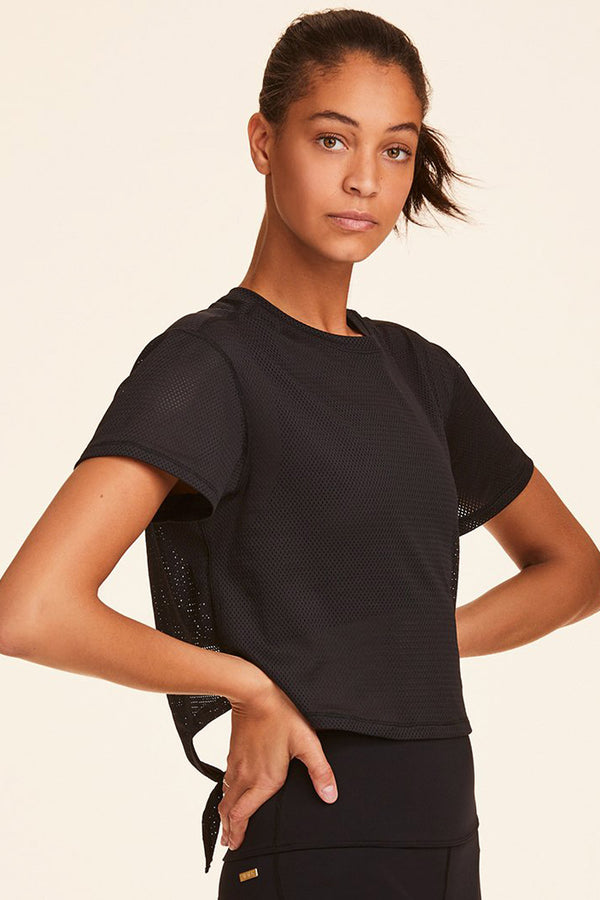 3/4 front view of Alala Women's Luxury Athleisure black mesh crop tee