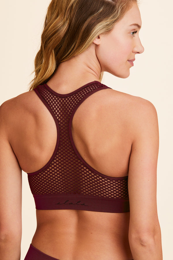 3/4 view of Alala Women's Luxury Athleisure burgundy seamless bra