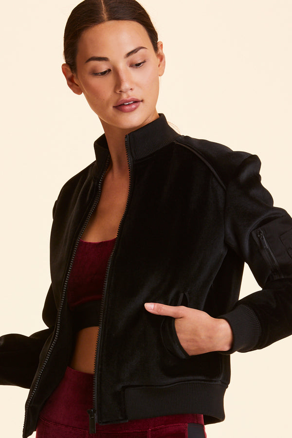 Front view of Alala Women's Luxury Athleisure black velvet bomber jacket
