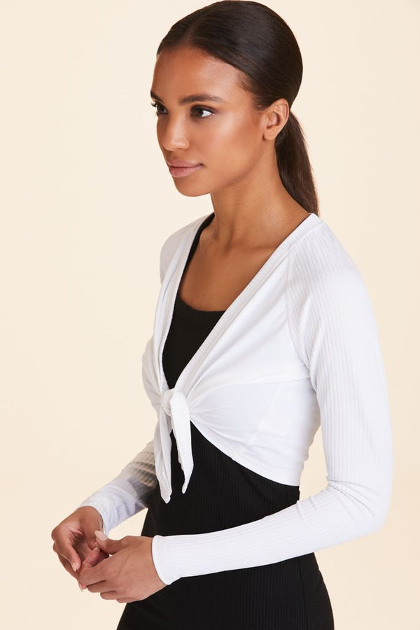 3/4 view of Alala Women's Luxury Athleisure white cropped wrap top