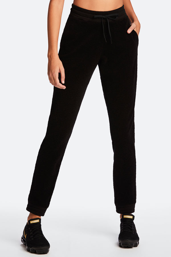 Front view of Alala Women's Luxury Athleisure black french terry sweatpant