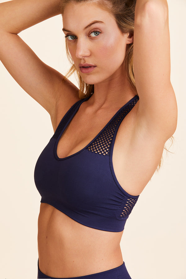 Side view of Alala Women's Luxury Athleisure navy blue seamless bra
