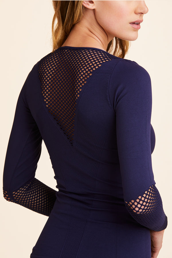 3/4 view of Alala Women's Luxury Athleisure navy blue seamless long sleeve tee with mesh detailing