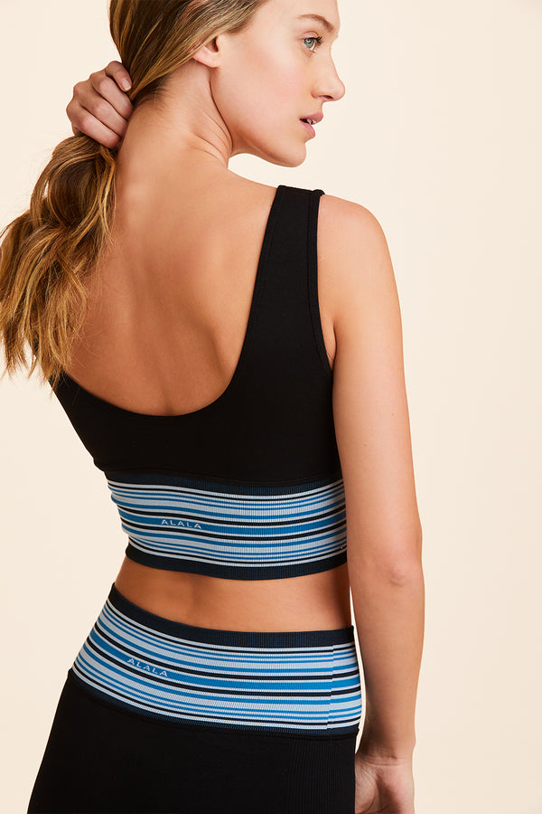 Front view of Alala Women's Luxury Athleisure black sports bra with blue wide striped band