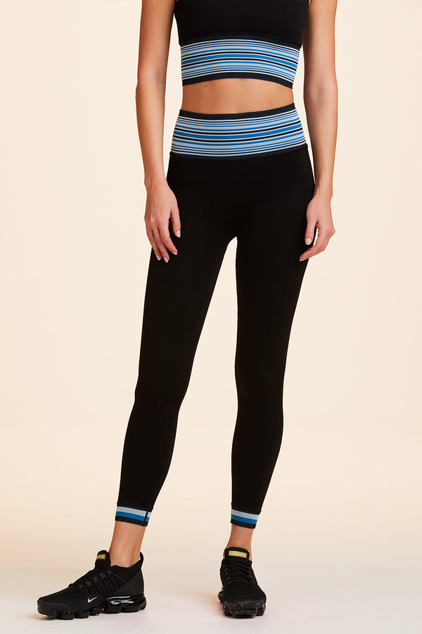 3/4 view of Alala Women's Luxury Athleisure black seamless tight with blue wide striped band