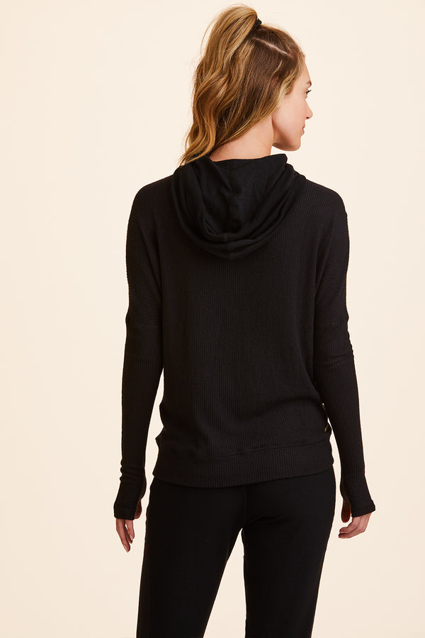Front view of Alala Women's Luxury Athleisure black hoodie