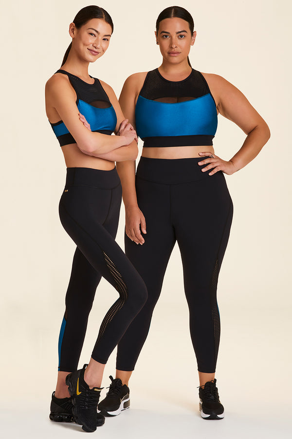 Front view of Alala Women's Luxury Athleisure black and teal sports bra with mesh detail