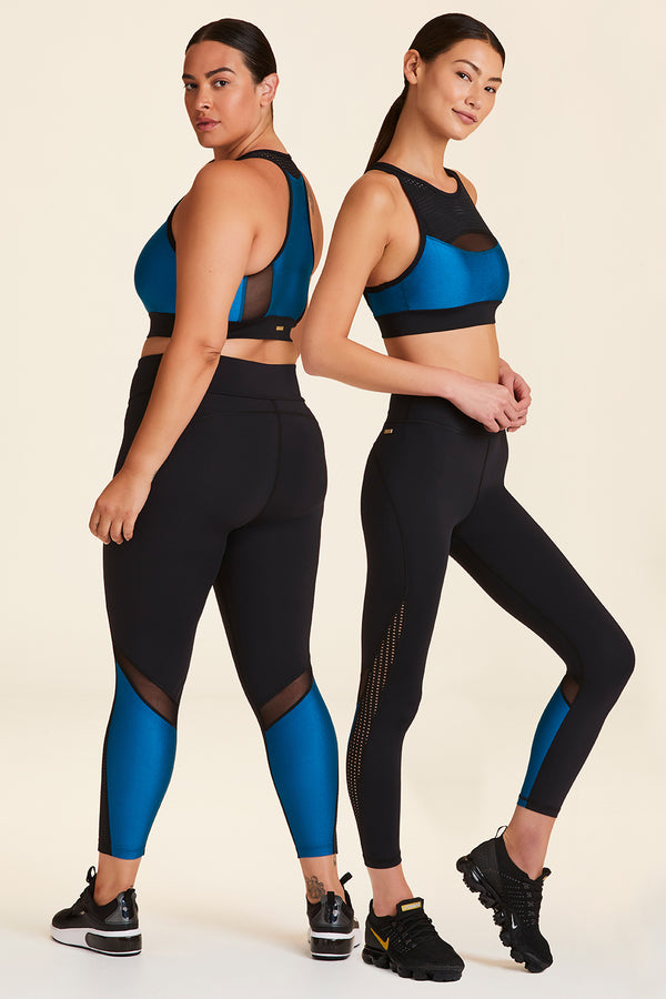 Back and side view of Alala Women's Luxury Athleisure black and teal 7/8 tight with minimal mesh detail