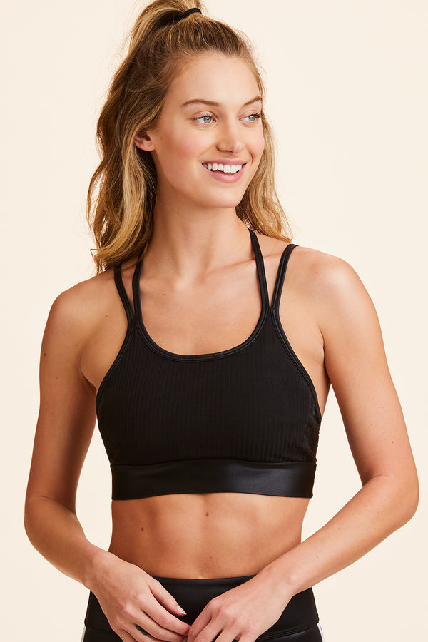 Back view of Alala Women's Luxury Athleisure black sports bra with multi-strap detail