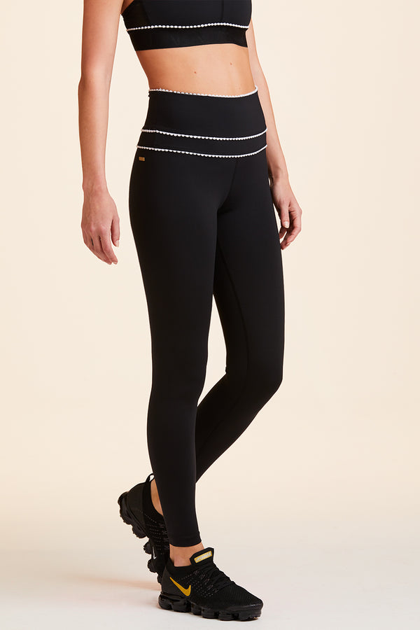 3/4 front view of Alala Women's Luxury Athleisure black tight with minimal white detail
