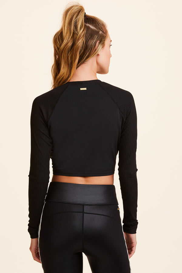 Front view of Alala Women's Luxury Athleisure black cropped wrap top
